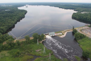 Morrow Lake, a reservoir created along the Kalamazoo River. The water is held in a reservoir by a dam. When water flows into the reservoir it slows, potentially letting some of the total suspended solids settle to the bottom of the river.