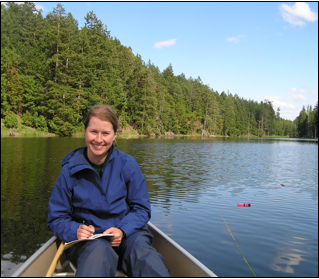 Scientist Alycia collecting fish from a freshwater lake in British Columbia, Canada.