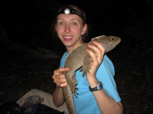 Kristine collecting data on a tuatara in the field.